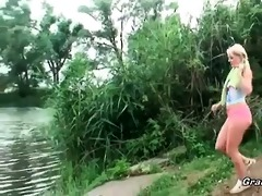 blond chick gives head in the nature