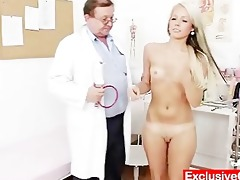 old doctor checks youthful golden-haired angel