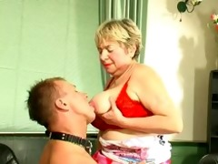 plump golden-haired russian granny plays with a